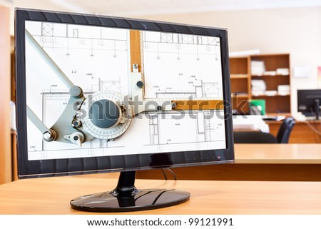 Computer monitor with blueprints and drawing board picture in screen on desktop - stock photo