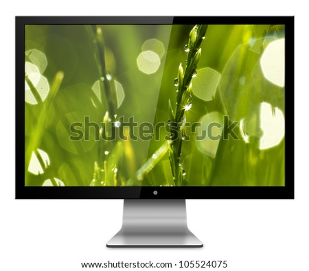 Computer Monitor with green greass on screen background. Isolated on white - stock photo