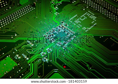 Computer motherboard abstract background in green color - stock photo
