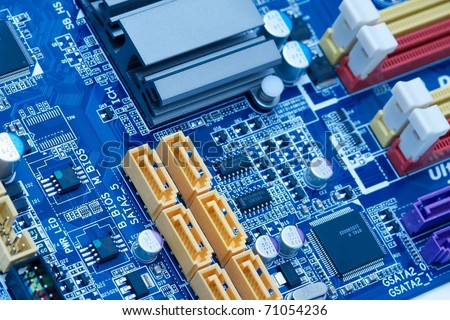 Computer motherboard electrical components - stock photo
