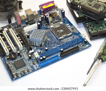 computer motherboard, hard disk repair industrial electronic  - stock photo