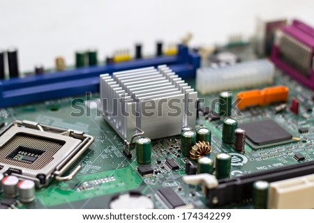 Computer motherboard isolated on white background - stock photo