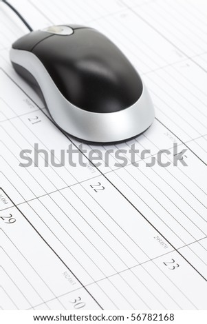 Computer Mouse and Calendar close up