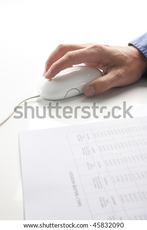 Computer mouse and hand. report foreground - stock photo