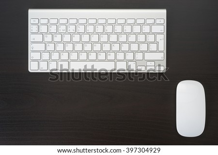 Computer mouse and keyboard in the workplace in the office - stock photo