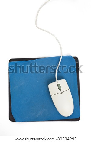 Computer Mouse and old Mouse pad close up - stock photo