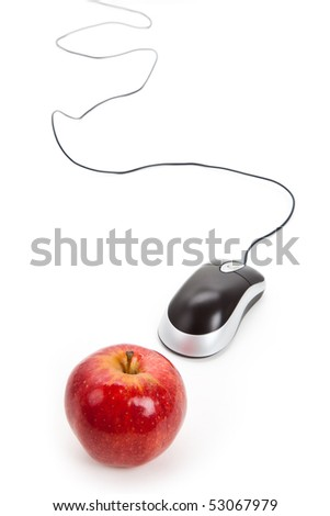 Computer Mouse and red apple close up - stock photo