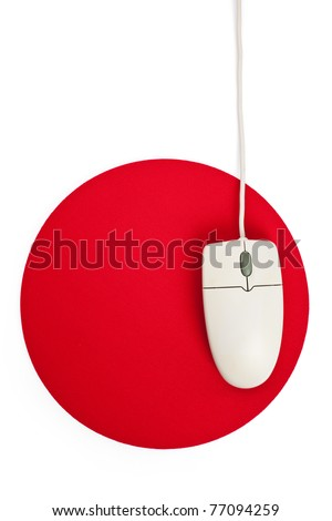 Computer Mouse and red Mouse pad close up - stock photo