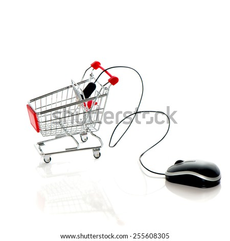 Computer mouse and shopping cart. Online market concept - stock photo