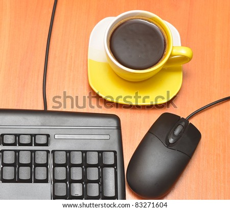 computer mouse, black keyboard and coffee cup - stock photo