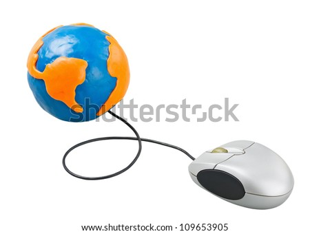 computer mouse connected to the globe of clay - stock photo