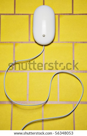 Computer mouse on post it notes - stock photo