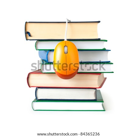 computer mouse on stack of books - stock photo