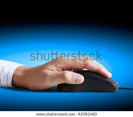 computer mouse with hand - stock photo