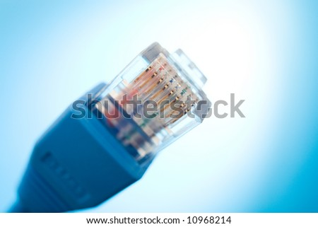 computer network connector on the blue background / rj45 - stock photo