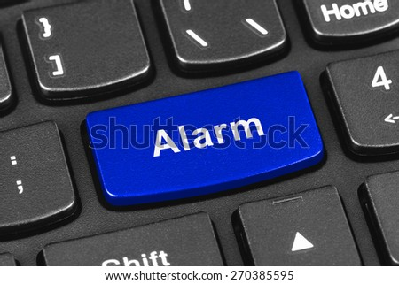 Computer notebook keyboard with Alarm key - technology background - stock photo