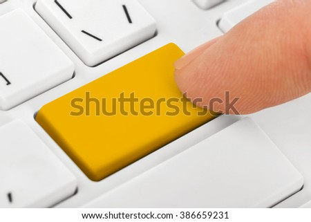 Computer notebook keyboard with blank yellow key - technology background - stock photo