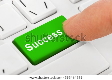 Computer notebook keyboard with Success key - technology background - stock photo