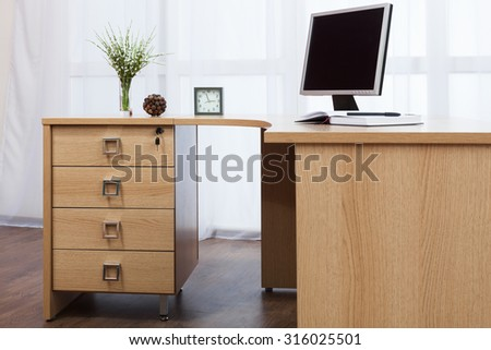 computer on desk in a modern office - stock photo