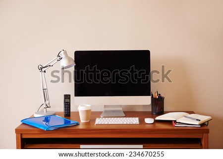 Computer On Desk In Home Office - stock photo