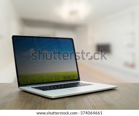 computer on old vintage wooden table in the living room - stock photo