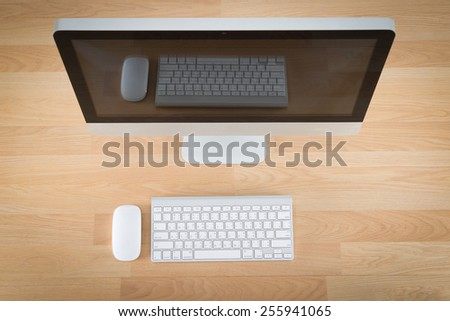Computer on wood table