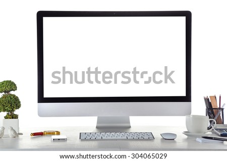 Computer on wooden table with blank white background - stock photo
