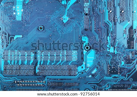 Computer part: downside of circuit board close-up. - stock photo