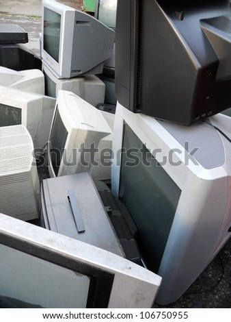 Computer parts and monitors landfill for electronic recycling - stock photo