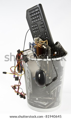 computer parts in trash can. grey background - stock photo