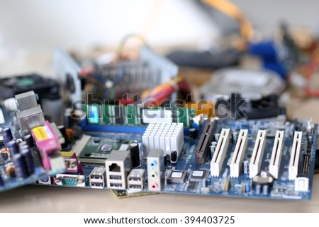Computer parts on the table in repair shop, close up - stock photo