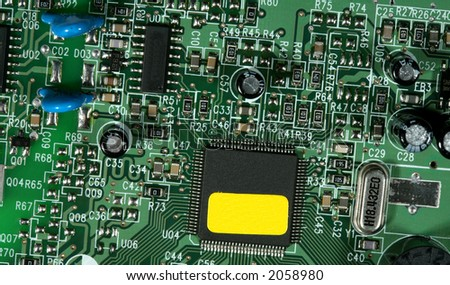 Computer PCB board with details of connections and electronic designs.