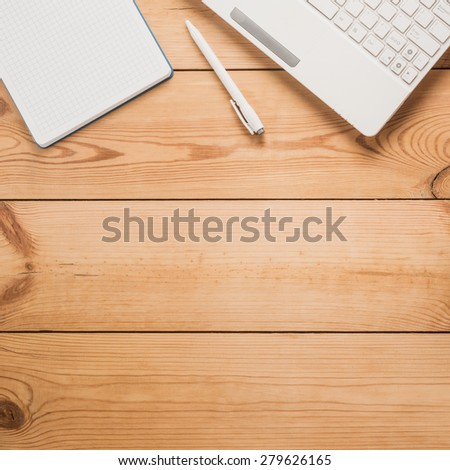 Computer, pen, notepad on a table   - stock photo