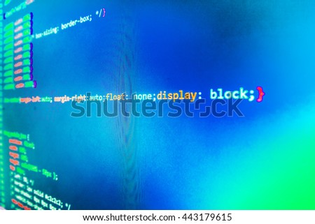 Computer program. Website programming code. Developer working on program codes in office.  Programmer occupation. Computer script.  Source code photo.  Website codes on computer monitor.   - stock photo