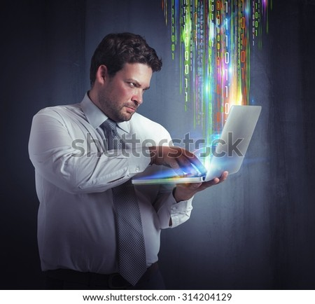 Computer programmer working as hacker with laptop - stock photo