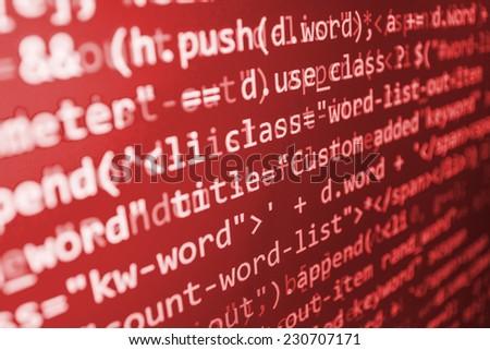 Computer red screen- danger, hacker, virus threat. Program application script code fragment. Bad software or online theft metaphore. Dark shadow and vignette spotlight effect. - stock photo