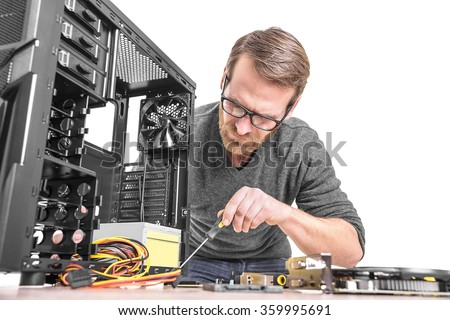 Computer repair. Computer technician working on a personal computer. - stock photo