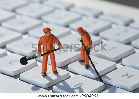 Computer repair concept men at work - stock photo