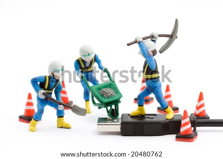 computer repair concept - usb cable repaired by workers isolated - stock photo
