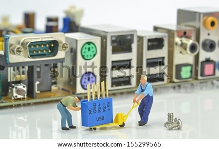 Computer repairs concept with mini figures and components - stock photo