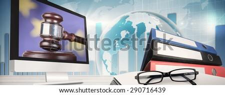 Computer screen against hand banging gavel on sounding block - stock photo