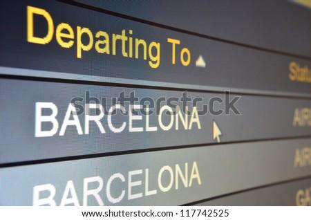Computer screen closeup of Barcelona flight status - stock photo