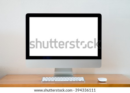 Computer screens isolated stand on a table. - stock photo