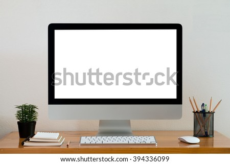Computer screens isolated stand on a table with note book. - stock photo