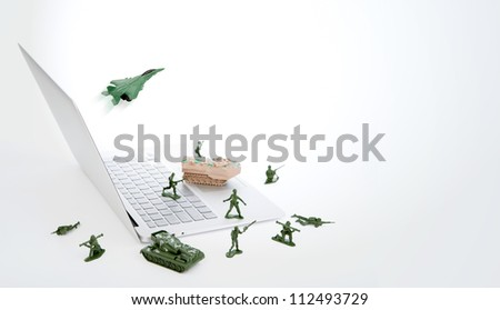 Computer security concept :  soldiers,tank,plane  are guarding a laptop from viruses, spyware and hacker - stock photo