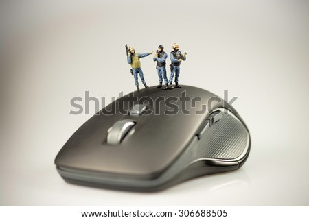 Computer security concept, swat team are guarding a computer. Macro photo - stock photo