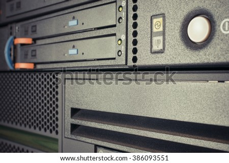 Computer Server and  CD or DVD and tape drive in datacenter , process in vintage style - stock photo