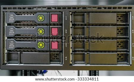 Computer Server and raid storage in datacenter - stock photo