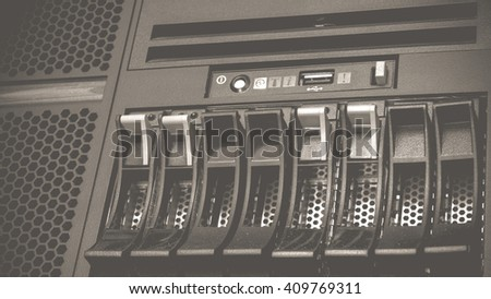 Computer Server and raid storage in datacenter , process in vintage black and white style. - stock photo