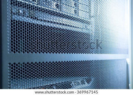 Computer Server in rack server close-up with blue light - stock photo